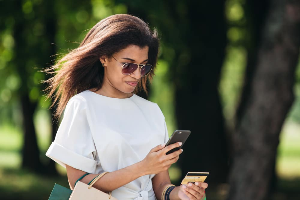 woman-sunglasses-cell-phone-credit-card.jpg